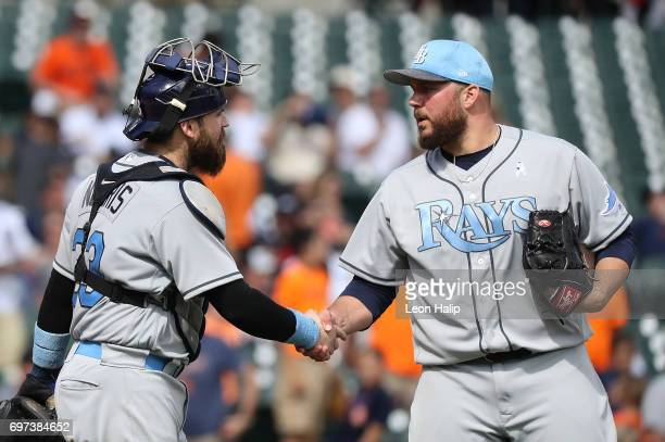 Derek Norris and Tommy Hunter of the Tampa Bay Rays celebrate a win over the Detroit Tigers on June 18 2017 at Comerica Park in Detroit Michigan...