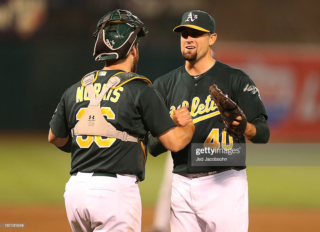 <a gi-track='captionPersonalityLinkClicked' href=/galleries/search?phrase=Derek+Norris&family=editorial&specificpeople=6795804 ng-click='$event.stopPropagation()'>Derek Norris</a> #36 of the Oakland Athletics celebrates with <a gi-track='captionPersonalityLinkClicked' href=/galleries/search?phrase=Pat+Neshek&family=editorial&specificpeople=743495 ng-click='$event.stopPropagation()'>Pat Neshek</a> #40 after defeating the Boston Red Sox during a Major League Baseball game at the O.co Coliseum on September 1, 2012 in Oakland, California.