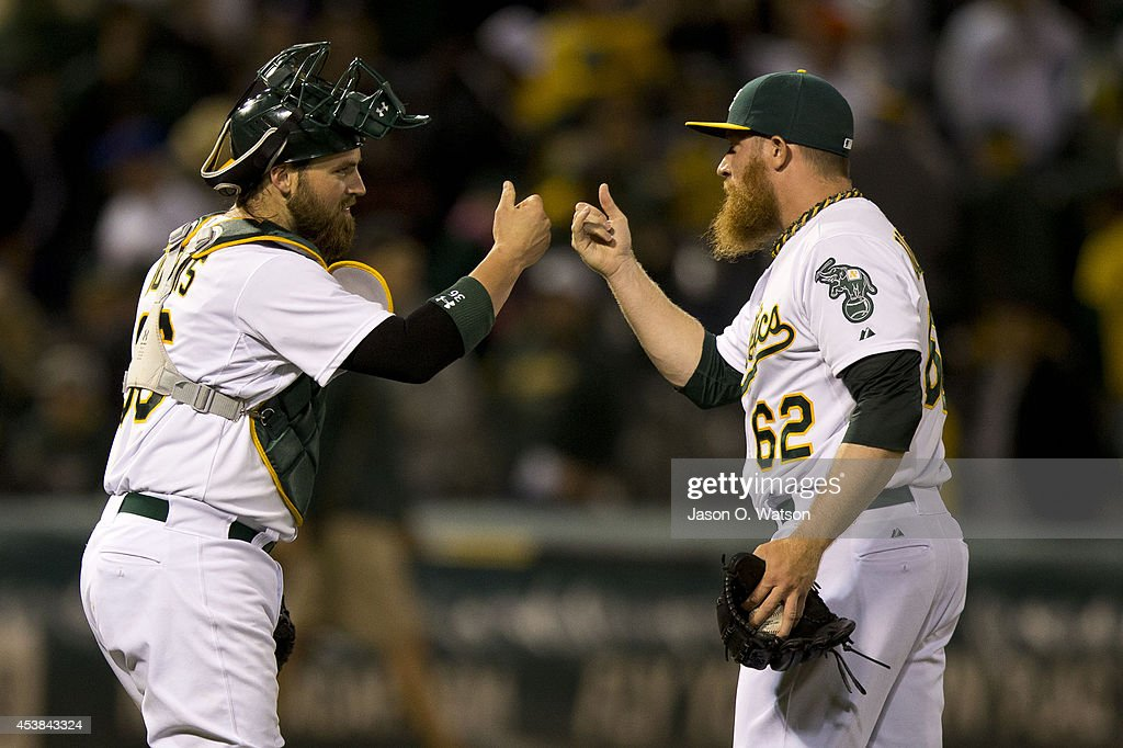 <a gi-track='captionPersonalityLinkClicked' href=/galleries/search?phrase=Derek+Norris&family=editorial&specificpeople=6795804 ng-click='$event.stopPropagation()'>Derek Norris</a> #36 of the Oakland Athletics celebrates with <a gi-track='captionPersonalityLinkClicked' href=/galleries/search?phrase=Sean+Doolittle&family=editorial&specificpeople=5740795 ng-click='$event.stopPropagation()'>Sean Doolittle</a> #62 after an interleague game against the New York Mets at O.co Coliseum on August 19, 2014 in Oakland, California. The Oakland Athletics defeated the New York Mets 6-2.