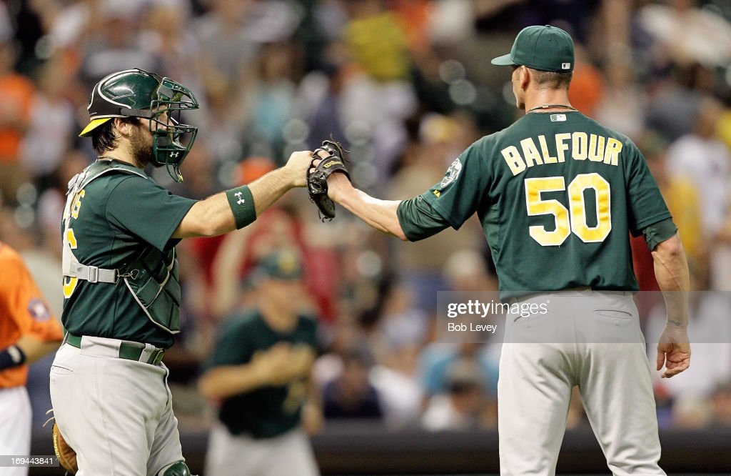 <a gi-track='captionPersonalityLinkClicked' href=/galleries/search?phrase=Derek+Norris&family=editorial&specificpeople=6795804 ng-click='$event.stopPropagation()'>Derek Norris</a> #36 of the Oakland Athletics congratulates -<a gi-track='captionPersonalityLinkClicked' href=/galleries/search?phrase=Grant+Balfour&family=editorial&specificpeople=833980 ng-click='$event.stopPropagation()'>Grant Balfour</a> #50 of the Oakland Athletics after the final out against the Houston Astros at Minute Maid Park on May 24, 2013 in Houston, Texas. Oakland Athletics won 6-5.