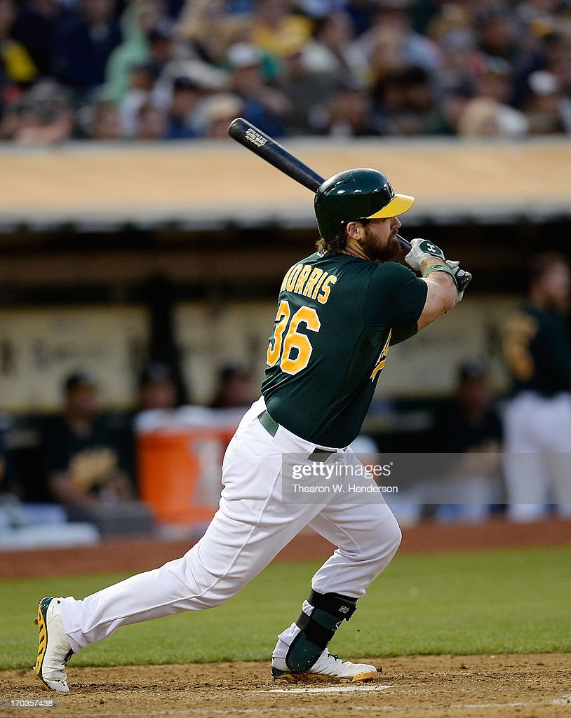 <a gi-track='captionPersonalityLinkClicked' href=/galleries/search?phrase=Derek+Norris&family=editorial&specificpeople=6795804 ng-click='$event.stopPropagation()'>Derek Norris</a> #36 of the Oakland Athletics hits a three-run homer against the New York Yankees in the fourth inning at O.co Coliseum on June 11, 2013 in Oakland, California.