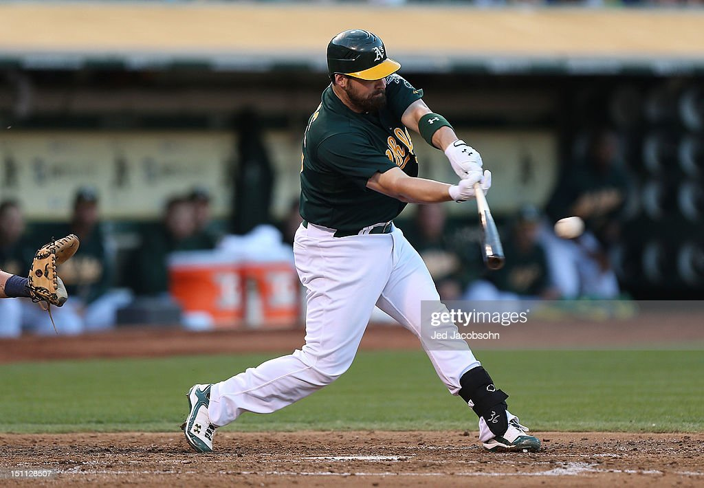 <a gi-track='captionPersonalityLinkClicked' href=/galleries/search?phrase=Derek+Norris&family=editorial&specificpeople=6795804 ng-click='$event.stopPropagation()'>Derek Norris</a> #36 of the Oakland Athletics hits an RBI single in the 3rd inning against the Boston Red Sox during a Major League Baseball game at the O.co Coliseum on September 1, 2012 in Oakland, California.