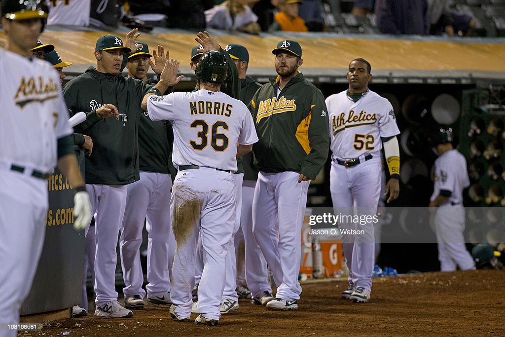 Derek Norris #36 of the Oakland Athletics is congratulated by teammates after scoring a run against the Los Angeles Angels of Anaheim during the fifteenth inning at O.co Coliseum on April 30, 2013 in Oakland, California. The Oakland Athletics defeated the Los Angeles Angels of Anaheim 10-8 in 19 innings.