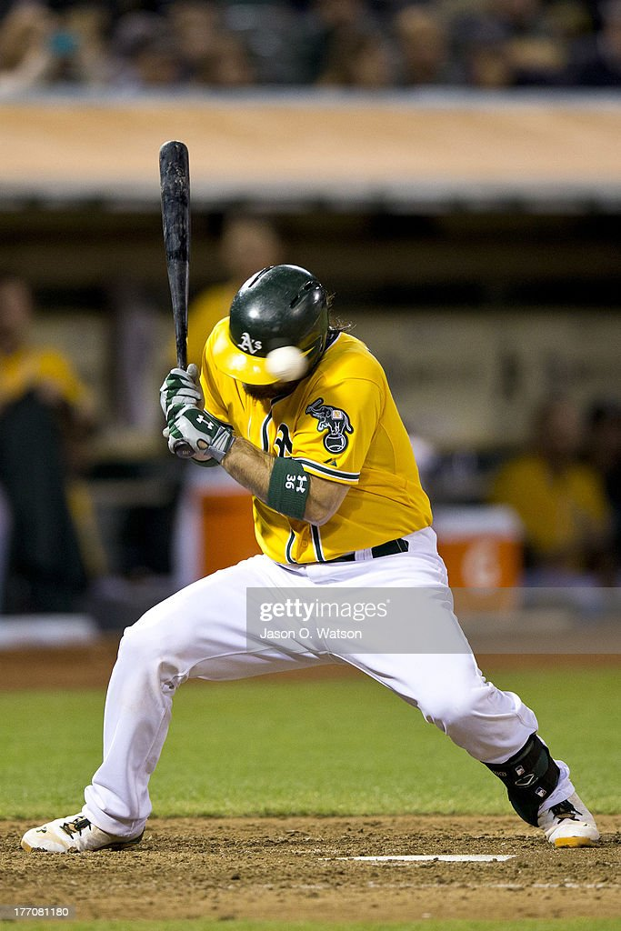 <a gi-track='captionPersonalityLinkClicked' href=/galleries/search?phrase=Derek+Norris&family=editorial&specificpeople=6795804 ng-click='$event.stopPropagation()'>Derek Norris</a> #36 of the Oakland Athletics is hit by a pitch from Brandon Maurer of the Seattle Mariners (not pictured) during the seventh inning at O.co Coliseum on August 20, 2013 in Oakland, California.