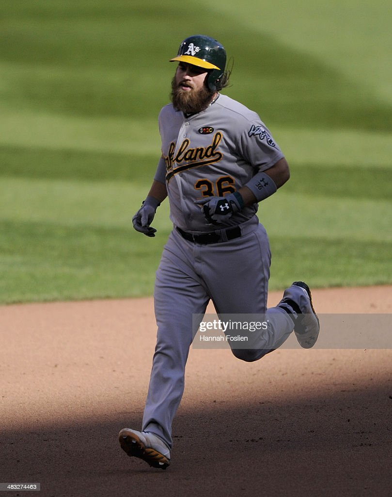 <a gi-track='captionPersonalityLinkClicked' href=/galleries/search?phrase=Derek+Norris&family=editorial&specificpeople=6795804 ng-click='$event.stopPropagation()'>Derek Norris</a> #36 of the Oakland Athletics rounds the bases after hitting a solo home run against the Minnesota Twins during the sixth inning of the home opening game on April 7, 2014 at Target Field in Minneapolis, Minnesota. The Athletics defeated the Twins 8-3.