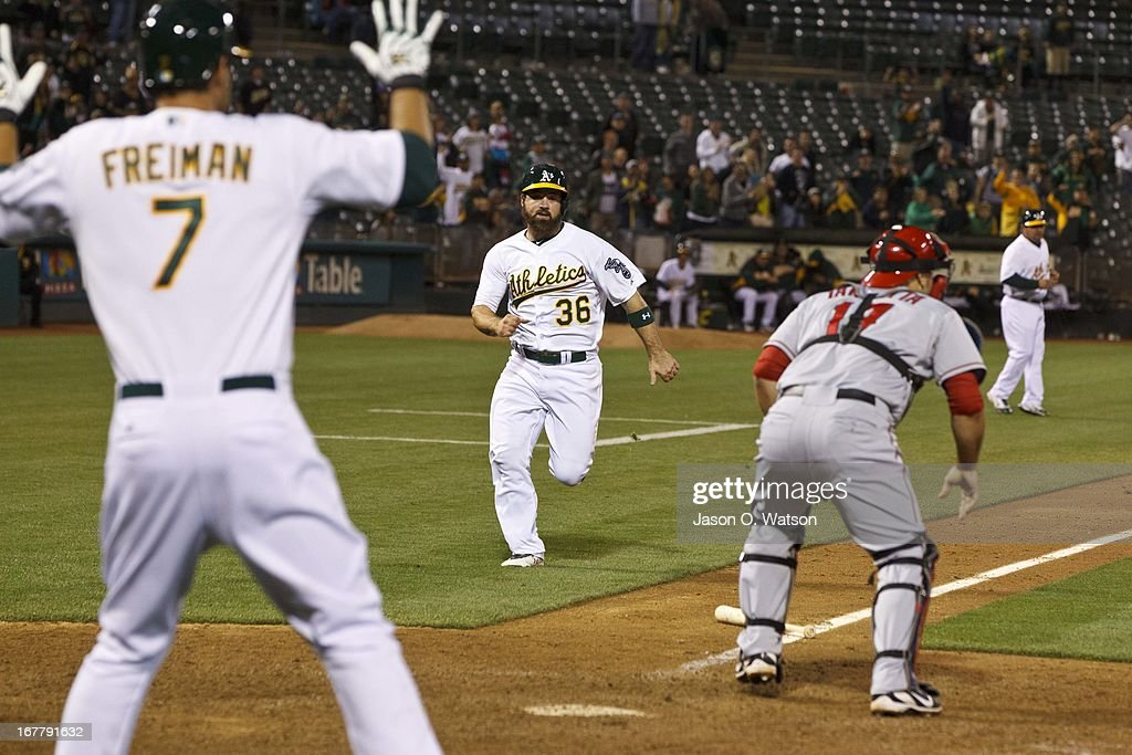 Derek Norris #36 of the Oakland Athletics scores a game tying run during the nineteenth inning against the Los Angeles Angels of Anaheim at O.co Coliseum on April 30, 2013 in Oakland, California. The Oakland Athletics defeated the Los Angeles Angels of Anaheim 10-8 in 19 innings.