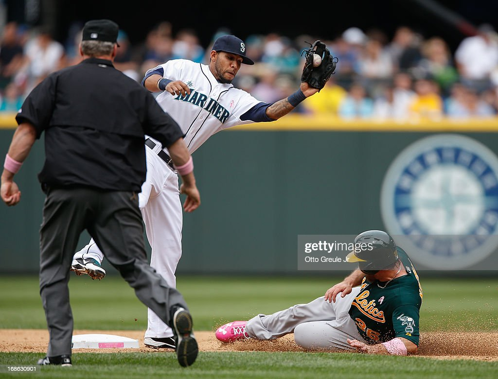 <a gi-track='captionPersonalityLinkClicked' href=/galleries/search?phrase=Derek+Norris&family=editorial&specificpeople=6795804 ng-click='$event.stopPropagation()'>Derek Norris</a> #36 of the Oakland Athletics steals second base against <a gi-track='captionPersonalityLinkClicked' href=/galleries/search?phrase=Robert+Andino&family=editorial&specificpeople=628104 ng-click='$event.stopPropagation()'>Robert Andino</a> #3 of the Seattle Mariners in the sixth inning at Safeco Field on May 12, 2013 in Seattle, Washington. The Mariners defeated the Athletics 6-1.