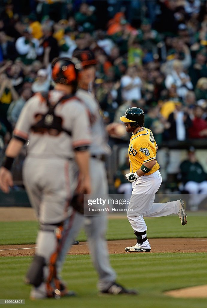 <a gi-track='captionPersonalityLinkClicked' href=/galleries/search?phrase=Derek+Norris&family=editorial&specificpeople=6795804 ng-click='$event.stopPropagation()'>Derek Norris</a> #36 of the Oakland Athletics trot around the bases after hitting a two-run homer as catcher <a gi-track='captionPersonalityLinkClicked' href=/galleries/search?phrase=Buster+Posey&family=editorial&specificpeople=4896435 ng-click='$event.stopPropagation()'>Buster Posey</a> #28 of the San Francisco Giants talks with pitcher Michael Kickham #59 in the second inning at O.co Coliseum on May 28, 2013 in Oakland, California.