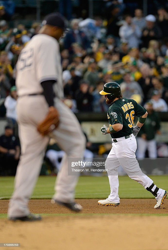 <a gi-track='captionPersonalityLinkClicked' href=/galleries/search?phrase=Derek+Norris&family=editorial&specificpeople=6795804 ng-click='$event.stopPropagation()'>Derek Norris</a> #36 of the Oakland Athletics trots around the bases after hitting a three-run homer as pitcher CC Sabathia #52 of the New York Yankees looks on in the fourth inning at O.co Coliseum on June 11, 2013 in Oakland, California.