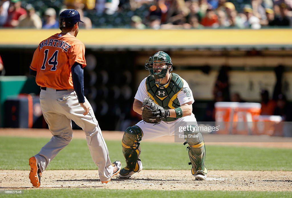 Derek Norris #36 of the Oakland Athletics waits to tag out J.D. Martinez #14 of the Houston Astros in the seventh inning at O.co Coliseum on April 17, 2013 in Oakland, California.