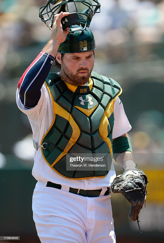 Derek Norris #36 of the Oakland Athletics walks back to the dugout after the first inning against the Chicago Cubs at O.co Coliseum on July 4, 2013 in Oakland, California.