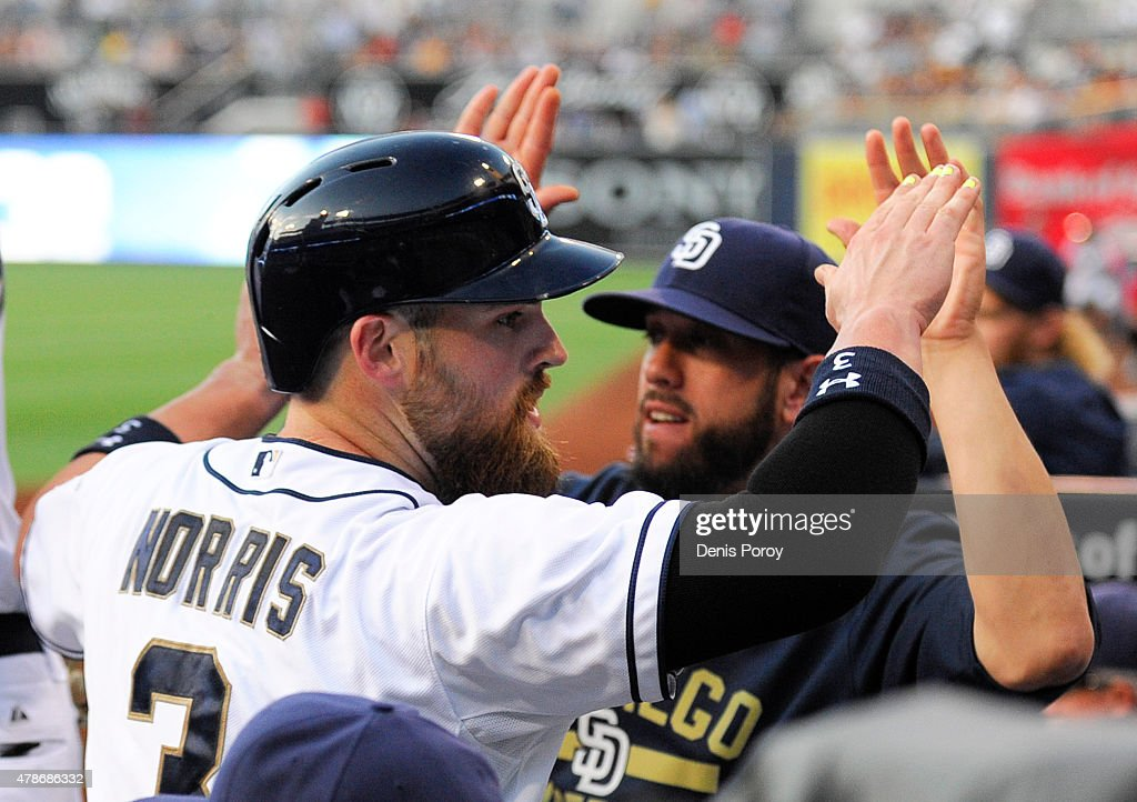 <a gi-track='captionPersonalityLinkClicked' href=/galleries/search?phrase=Derek+Norris&family=editorial&specificpeople=6795804 ng-click='$event.stopPropagation()'>Derek Norris</a> #3 of the San Diego Padres, left, is congratulated by <a gi-track='captionPersonalityLinkClicked' href=/galleries/search?phrase=James+Shields+-+Jogador+de+basebol&family=editorial&specificpeople=8138267 ng-click='$event.stopPropagation()'>James Shields</a> after scoring during the first inning of a baseball game against the Arizona Diamondbacks at Petco Park June 26, 2015 in San Diego, California.