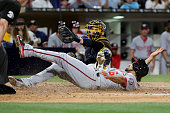 Derek Norris of the San Diego Padres tags out Anthony Rendon of the Washington Nationals at home during the sixth inning of a baseball game at PETCO...