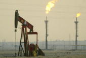 A derek pumps in a oil field January 15 2003 near the Saudi Arabian border Kuwait Kuwait produces 10% of the worlds oil and has promised to increase...