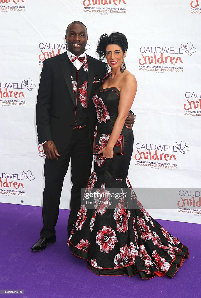 Derek Redmond and guest attend The Diamond Butterfly Ball in aid Of Caudwell Children at Battersea Evolution on May 31, 2012 in London, England.