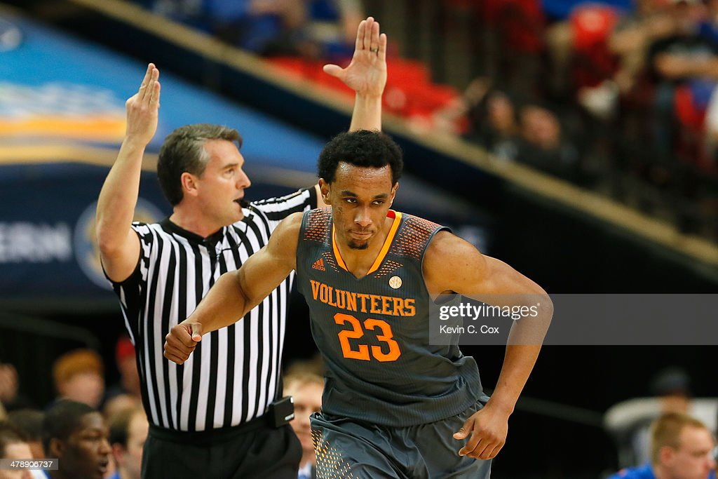 Derek Reese #23 of the Tennessee Volunteers reacts after scoring against the Florida Gators during the semifinals of the SEC Men's Basketball Tournament at Georgia Dome on March 15, 2014 in Atlanta, Georgia.