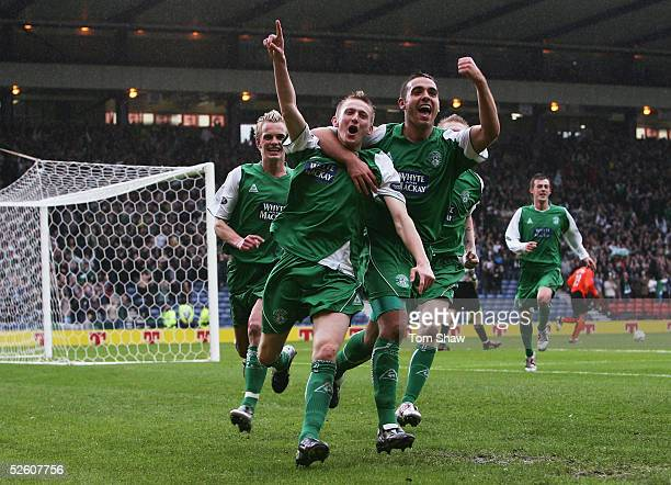 Derek Riordan of Hibs celebrates scoring from the penalty spot during the Tennents Scottish Cup SemiFinal between Dundee United and Hibernian at...