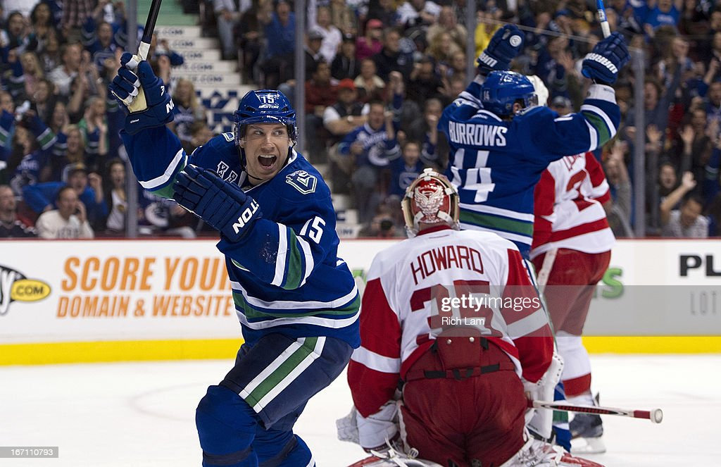 Derek Roy #15 and Alexandre Burrows #14 of the Vancouver Canucks celebrate after teammate Alexander Edler #23 scored on goalie Jimmy Howard #35 of the Detroit Red Wings during the first period in NHL action on April 20, 2013 at Rogers Arena in Vancouver, British Columbia, Canada.
