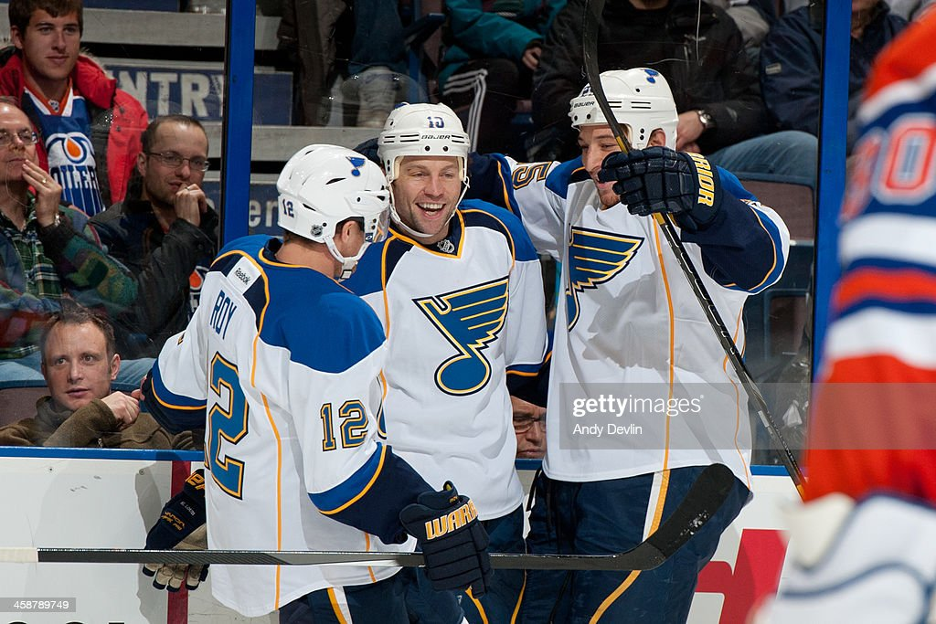 <a gi-track='captionPersonalityLinkClicked' href=/galleries/search?phrase=Derek+Roy&family=editorial&specificpeople=203272 ng-click='$event.stopPropagation()'>Derek Roy</a> #12, <a gi-track='captionPersonalityLinkClicked' href=/galleries/search?phrase=Brenden+Morrow&family=editorial&specificpeople=202256 ng-click='$event.stopPropagation()'>Brenden Morrow</a> #10 and Chris Stewart #25 of the St. Louis Blues celebrate after a goal in a game against the Edmonton Oilers on December 21, 2013 at Rexall Place in Edmonton, Alberta, Canada.