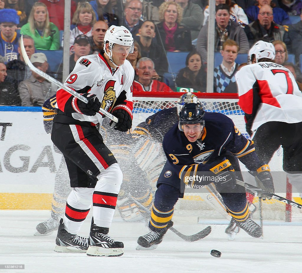 <a gi-track='captionPersonalityLinkClicked' href=/galleries/search?phrase=Derek+Roy&family=editorial&specificpeople=203272 ng-click='$event.stopPropagation()'>Derek Roy</a> #9 of the Buffalo Sabres and <a gi-track='captionPersonalityLinkClicked' href=/galleries/search?phrase=Jason+Spezza&family=editorial&specificpeople=202023 ng-click='$event.stopPropagation()'>Jason Spezza</a> #19 of the Ottawa Senators battle for the puck at First Niagara Center on November 11, 2011 in Buffalo, New York.