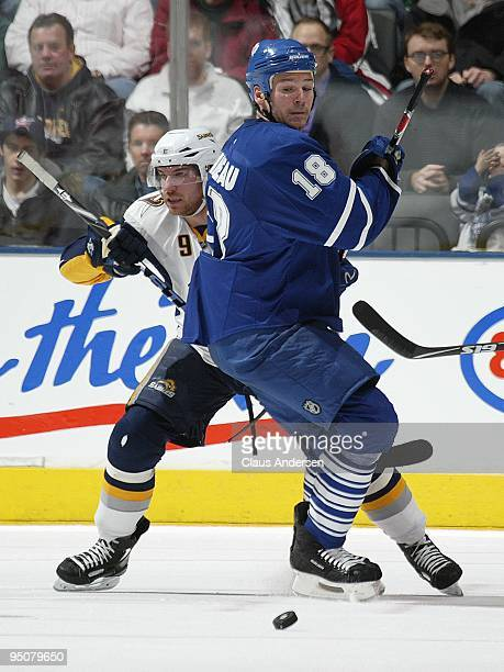 Derek Roy of the Buffalo Sabres battles for puck control with Wayne Primeau of the Toronto Maple Leafs in a game on December 21 2009 at the Air...