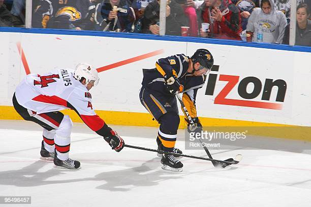 Derek Roy of the Buffalo Sabres handles the puck against Chris Phillips of the Ottawa Senators on December 26 2009 at HSBC Arena in Buffalo New York