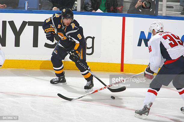 Derek Roy of the Buffalo Sabres handles the puck against David Steckel of the Washington Capitals on December 9 2009 at HSBC Arena in Buffalo New York
