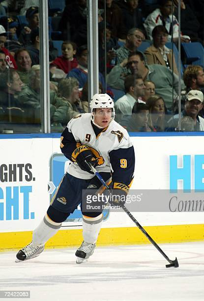 Derek Roy of the Buffalo Sabres handles the puck against the New York Islanders on October 26 2006 at the Nassau Coliseum in Uniondale New York The...