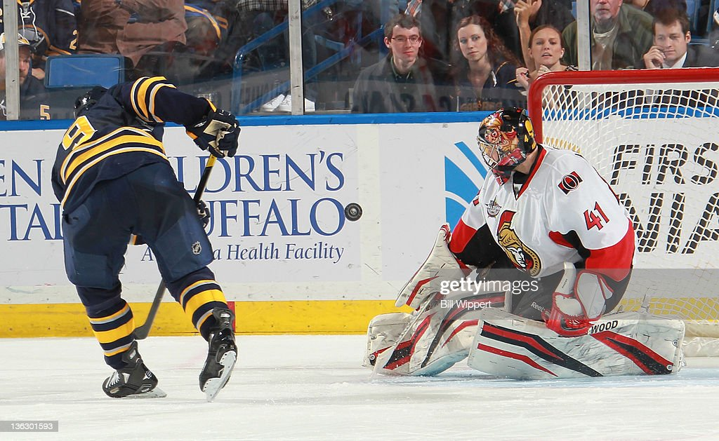<a gi-track='captionPersonalityLinkClicked' href=/galleries/search?phrase=Derek+Roy&family=editorial&specificpeople=203272 ng-click='$event.stopPropagation()'>Derek Roy</a> #9 of the Buffalo Sabres has his shootout attempt stopped by <a gi-track='captionPersonalityLinkClicked' href=/galleries/search?phrase=Craig+Anderson&family=editorial&specificpeople=211238 ng-click='$event.stopPropagation()'>Craig Anderson</a> #41 of the Ottawa Senators at First Niagara Center on December 31, 2011 in Buffalo, New York. Ottawa defeated Buffalo, 3-2.