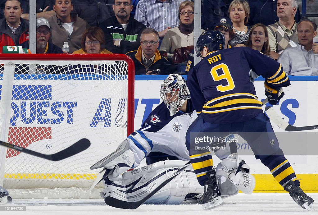 <a gi-track='captionPersonalityLinkClicked' href=/galleries/search?phrase=Derek+Roy&family=editorial&specificpeople=203272 ng-click='$event.stopPropagation()'>Derek Roy</a> #9 of the Buffalo Sabres scores on Ondrej Pavelec #31 of the Winnipeg Jets during their NHL game at First Niagara Center November 8, 2011 in Buffalo, New York.
