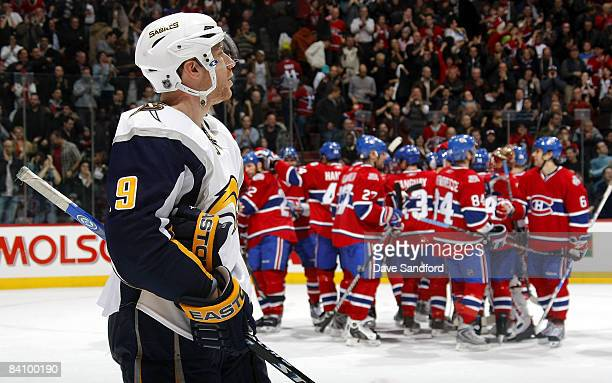 Derek Roy of the Buffalo Sabres skates off the ice as the Montreal Canadiens celebrate their overtime victory during their NHL game at the Bell...