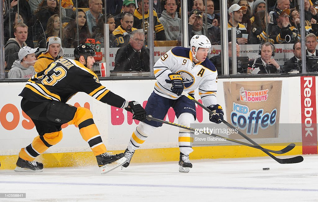 <a gi-track='captionPersonalityLinkClicked' href=/galleries/search?phrase=Derek+Roy&family=editorial&specificpeople=203272 ng-click='$event.stopPropagation()'>Derek Roy</a> #9 of the Buffalo Sabres skates with the puck against <a gi-track='captionPersonalityLinkClicked' href=/galleries/search?phrase=Zdeno+Chara&family=editorial&specificpeople=203177 ng-click='$event.stopPropagation()'>Zdeno Chara</a> #33 of the Boston Bruins at the TD Garden on April 7, 2012 in Boston, Massachusetts.