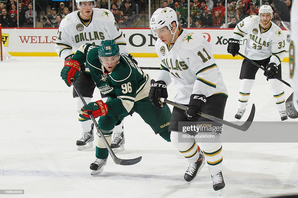 <a gi-track='captionPersonalityLinkClicked' href=/galleries/search?phrase=Derek+Roy&family=editorial&specificpeople=203272 ng-click='$event.stopPropagation()'>Derek Roy</a> #11 of the Dallas Stars and Pierre-Marc Bouchard #96 of the Minnesota Wild skate to the puck during the game on January 20, 2013 at the Xcel Energy Center in Saint Paul, Minnesota.