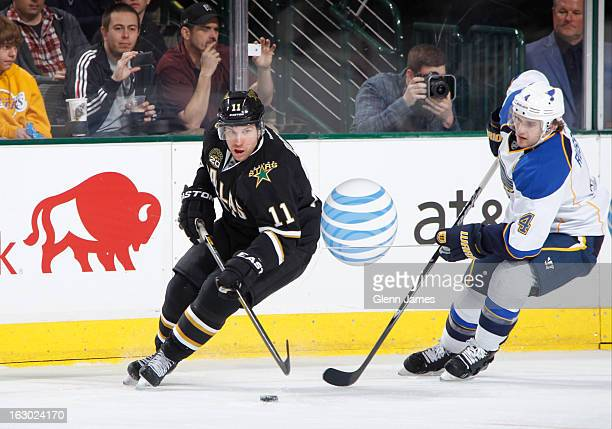Derek Roy of the Dallas Stars handles the puck against Kris Russell of the St Louis Blues at the American Airlines Center on March 3 2013 in Dallas...