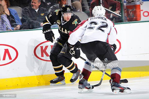 Derek Roy of the Dallas Stars handles the puck against Matt Hunwick of the Colorado Avalanche at the American Airlines Center on March 23 2013 in...