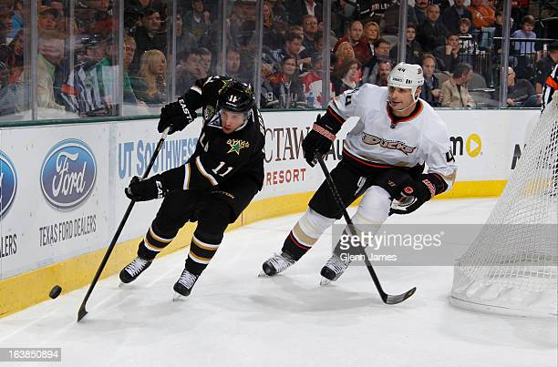 Derek Roy of the Dallas Stars handles the puck against Sheldon Souray of the Anaheim Ducks at the American Airlines Center on March 14 2013 in Dallas...