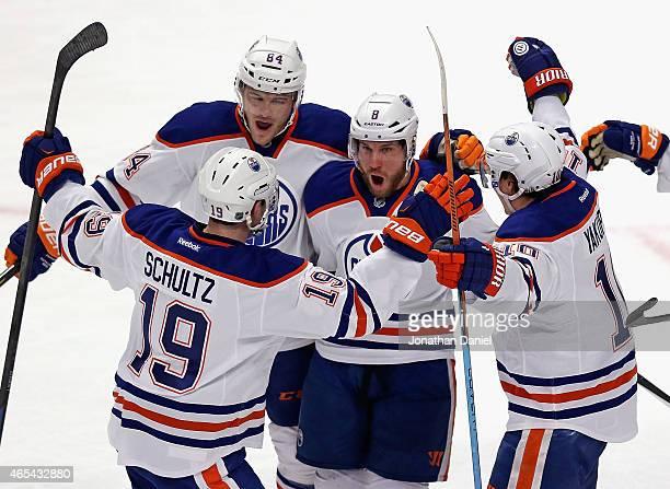 Derek Roy of the Edmonton Oilers celebrates his first period goal with teammates Justin Schultz Oscar Klefbom and Nail Yakupov against the Chicago...