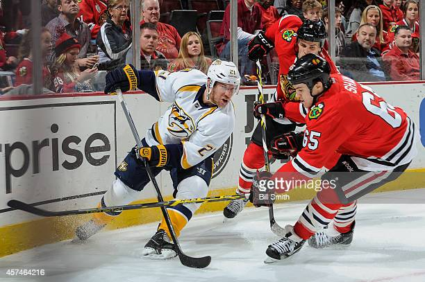 Derek Roy of the Nashville Predators handles the puck against Niklas Hjalmarsson and Andrew Shaw of the Chicago Blackhawks during the NHL game on...