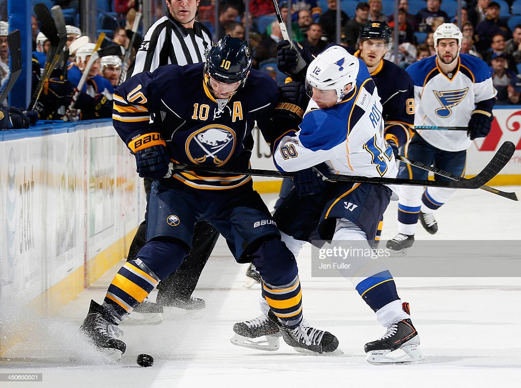 <a gi-track='captionPersonalityLinkClicked' href=/galleries/search?phrase=Derek+Roy&family=editorial&specificpeople=203272 ng-click='$event.stopPropagation()'>Derek Roy</a> #12 of the St. Louis Blues battles for the puck with <a gi-track='captionPersonalityLinkClicked' href=/galleries/search?phrase=Christian+Ehrhoff&family=editorial&specificpeople=214788 ng-click='$event.stopPropagation()'>Christian Ehrhoff</a> #10 of the Buffalo Sabres at First Niagara Center on November 19, 2013 in Buffalo, New York. St. Louis defeated Buffalo 4-1.