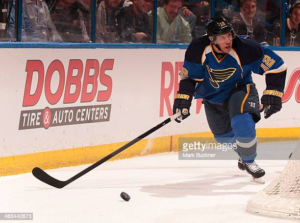 Derek Roy of the St Louis Blues handles the puck against the Washington Capitals during an NHL game on April 8 2014 at Scottrade Center in St Louis...