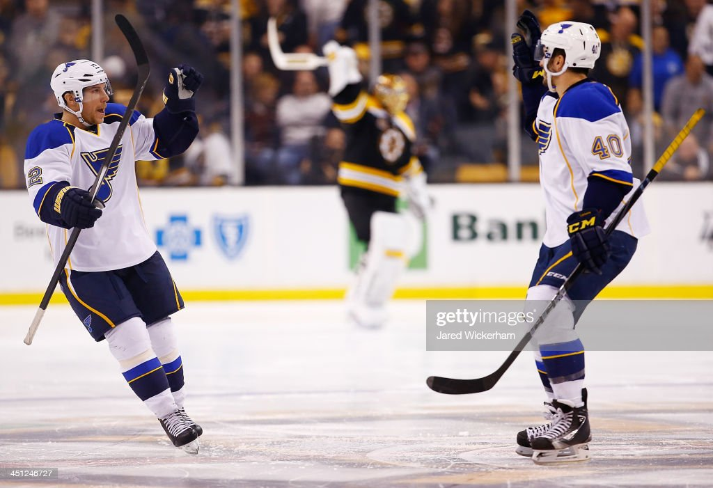 Derek Roy #12 of the St Louis Blues is congratulated by teammate Maxim Lapierre #40 after scoring the game-winning goal past Tuukka Rask #40 of the Boston Bruins an overtime shootout at TD Garden on November 21, 2013 in Boston, Massachusetts.