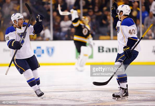 Derek Roy of the St Louis Blues is congratulated by teammate Maxim Lapierre after scoring the gamewinning goal past Tuukka Rask of the Boston Bruins...
