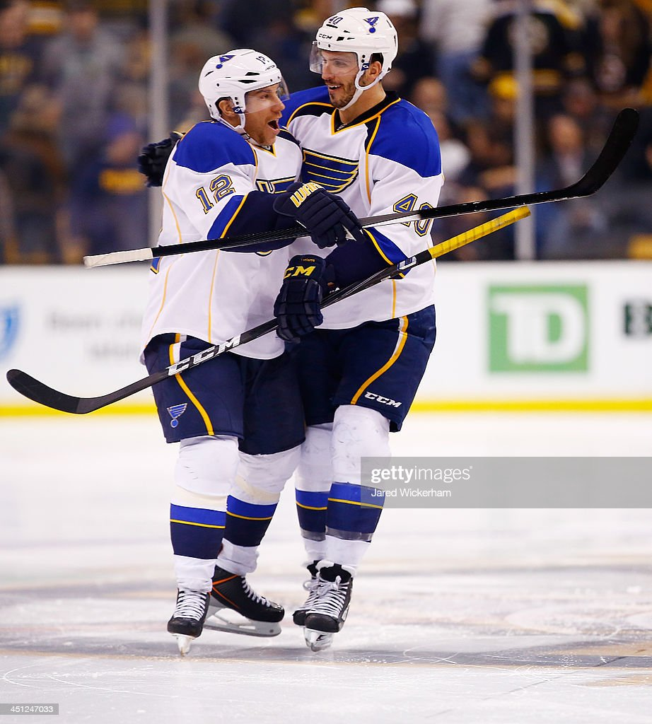<a gi-track='captionPersonalityLinkClicked' href=/galleries/search?phrase=Derek+Roy&family=editorial&specificpeople=203272 ng-click='$event.stopPropagation()'>Derek Roy</a> #12 of the St Louis Blues is congratulated by teammate <a gi-track='captionPersonalityLinkClicked' href=/galleries/search?phrase=Maxim+Lapierre&family=editorial&specificpeople=718385 ng-click='$event.stopPropagation()'>Maxim Lapierre</a> #40 after scoring the game-winning goal past Tuukka Rask #40 of the Boston Bruins an overtime shootout at TD Garden on November 21, 2013 in Boston, Massachusetts.