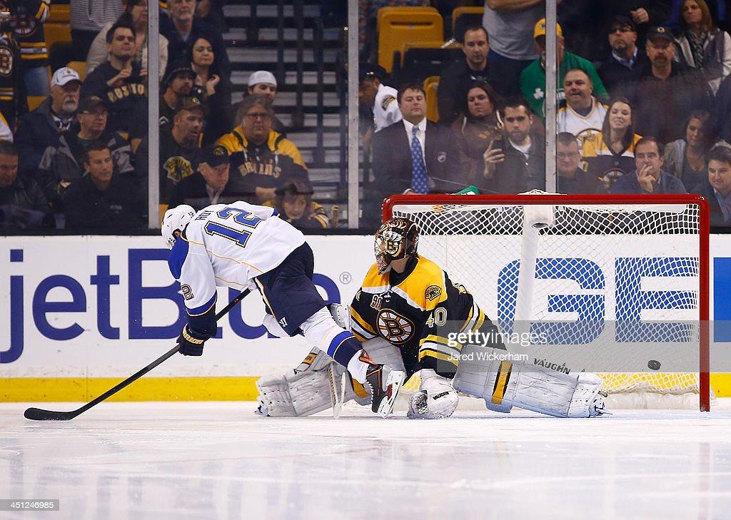 Derek Roy #12 of the St Louis Blues scores the game-winning goal past Tuukka Rask #40 of the Boston Bruins an overtime shootout at TD Garden on November 21, 2013 in Boston, Massachusetts.