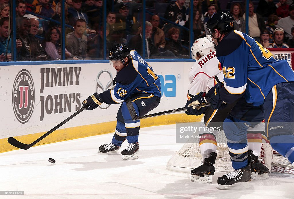 <a gi-track='captionPersonalityLinkClicked' href=/galleries/search?phrase=Derek+Roy&family=editorial&specificpeople=203272 ng-click='$event.stopPropagation()'>Derek Roy</a> #12 of the St. Louis Blues skates against the Calgary Flames on November 7, 2013 at Scottrade Center in St. Louis, Missouri.