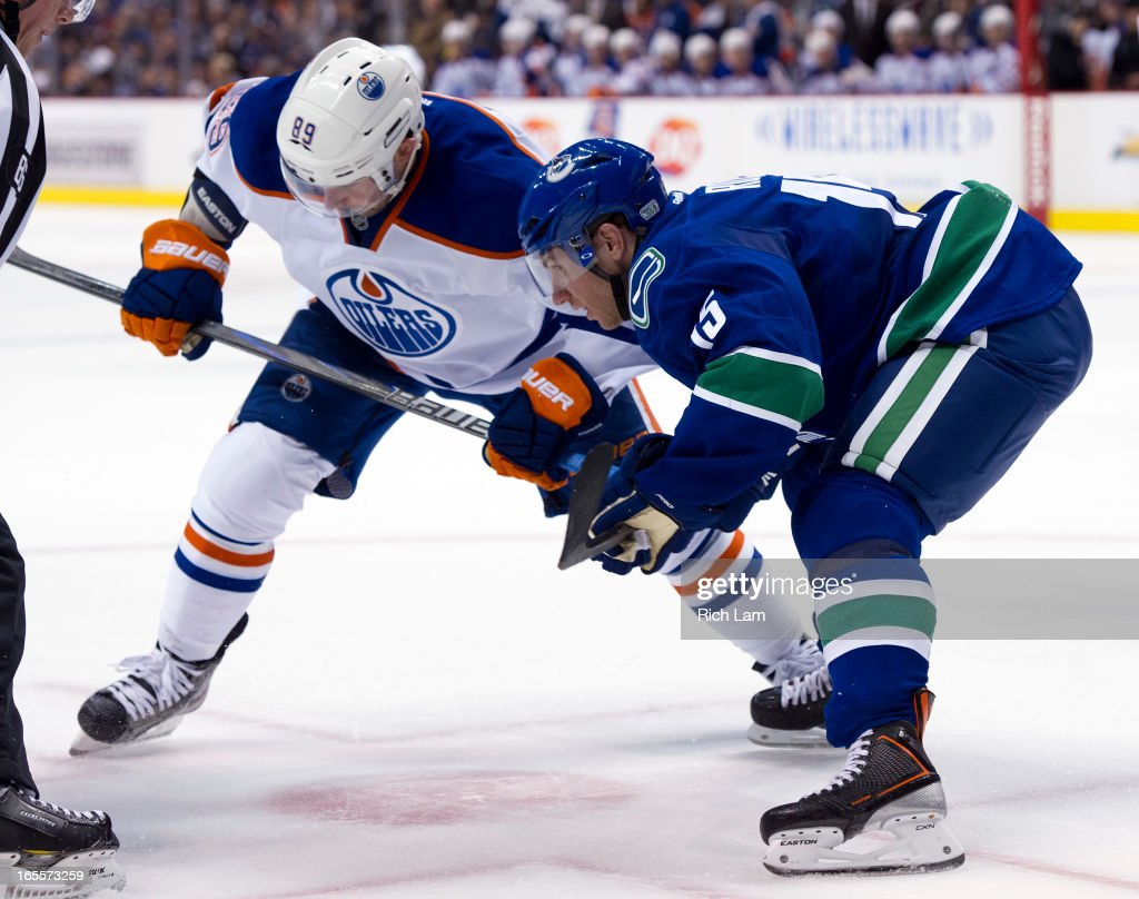 <a gi-track='captionPersonalityLinkClicked' href=/galleries/search?phrase=Derek+Roy&family=editorial&specificpeople=203272 ng-click='$event.stopPropagation()'>Derek Roy</a> #15 of the Vancouver Canucks takes a face-off against <a gi-track='captionPersonalityLinkClicked' href=/galleries/search?phrase=Sam+Gagner&family=editorial&specificpeople=4042961 ng-click='$event.stopPropagation()'>Sam Gagner</a> #89 of the Edmonton Oilers during first period of NHL action on April 04, 2013 at Rogers Arena in Vancouver, British Columbia, Canada.