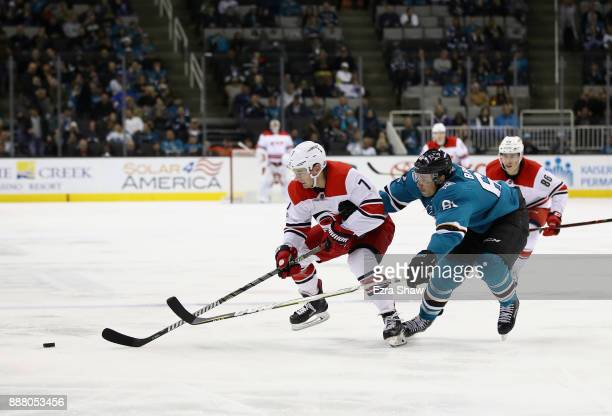 Derek Ryan of the Carolina Hurricanes and Justin Braun of the San Jose Sharks go for the puck at SAP Center on December 7 2017 in San Jose California