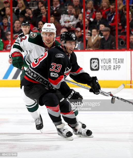 Derek Ryan of the Carolina Hurricanes and Nino Niederreiter of the Minnesota Wild battle for position during an NHL game on March 16 2017 at PNC...