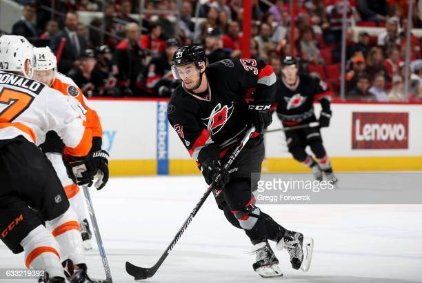 Derek Ryan of the Carolina Hurricanes carries the puck during an NHL game against the Philadelphia Flyers on January 31 2017 at PNC Arena in Raleigh...