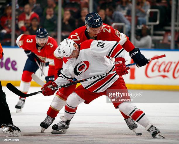 Derek Ryan of the Carolina Hurricanes faces off against Nick Bjugstad of the Florida Panthers at the BBT Center on March 21 2017 in Sunrise Florida
